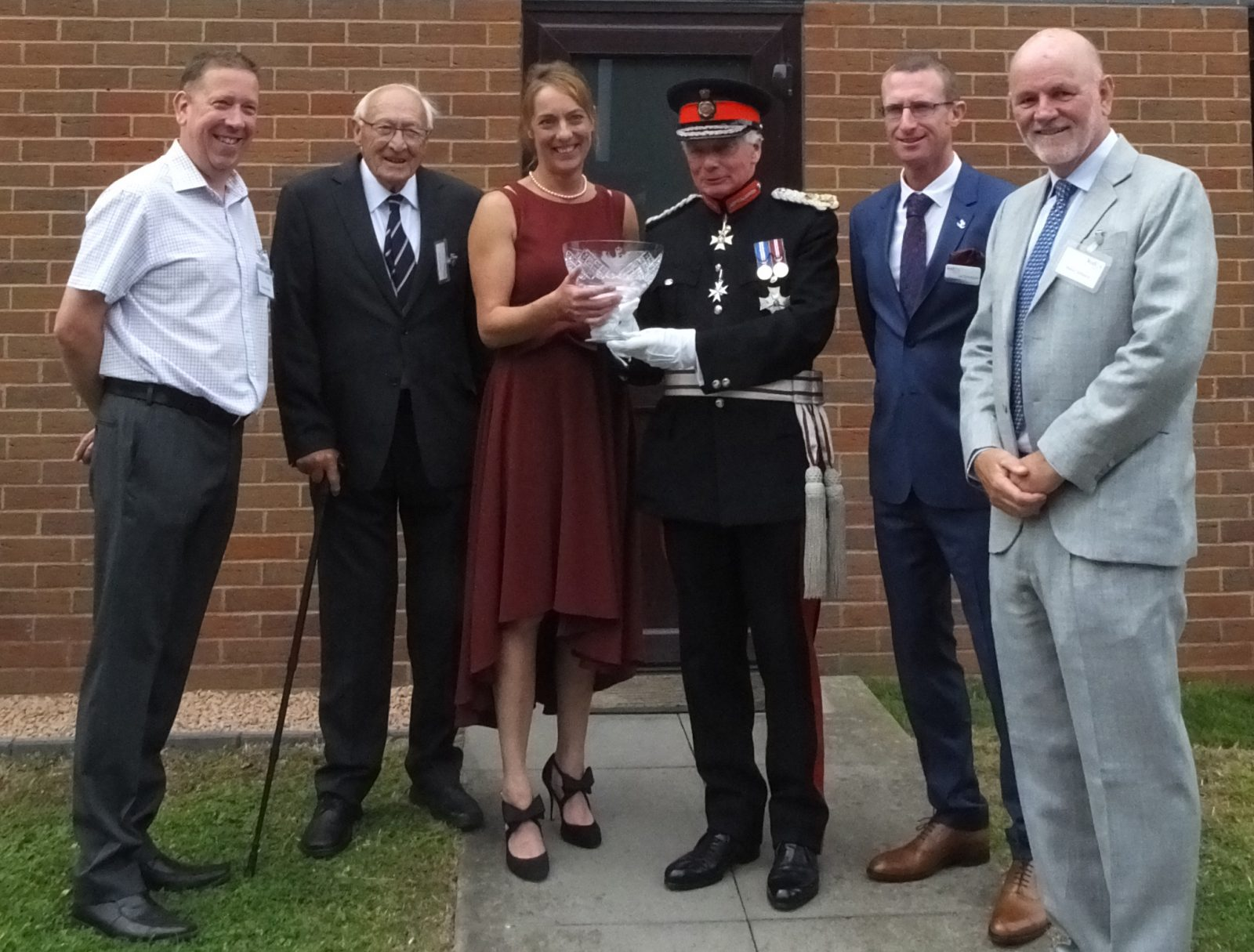 "Kudos Blends, based in Cleobury Mortimer, Shropshire celebrate a Queen's Award for Enterprise in the category of International Trade. The award was presented by Sir Algernon Heber-Percy, Lord Lieutenant of Shropshire at a champagne reception. Pictured here, Dinnie Jordan (founder and MD) accepts the award, accompanied by honoured guests, the very closest ""Friends of Kudos""."