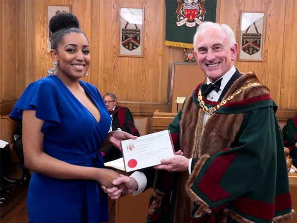 Natalie Brown receives award from Master