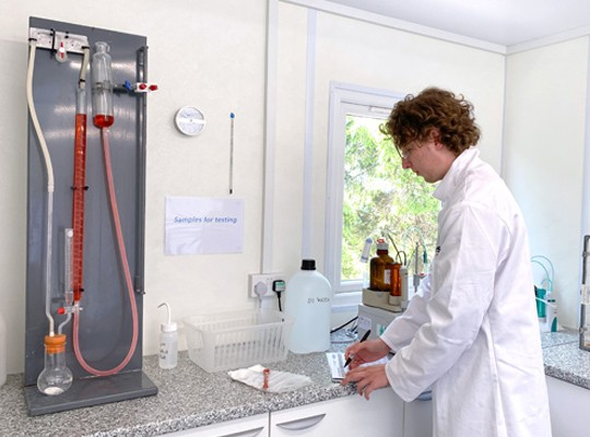 Laboratory technician working in the Quality Control cabin